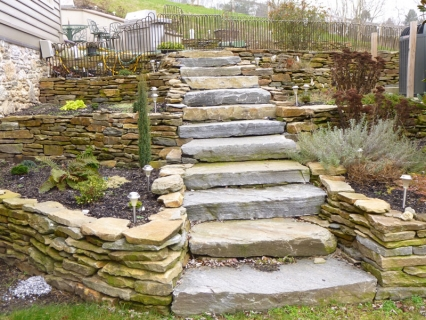 Flagstone flowerbeds and stone steps