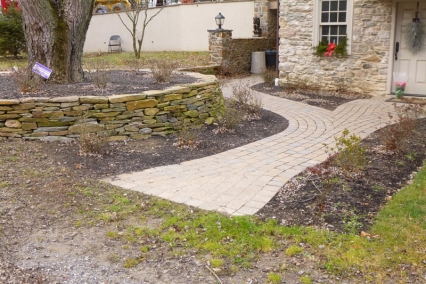 Walkway and flagstone flower bed